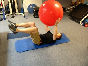 Exercise ball crunch pass