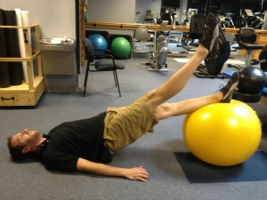 Exercise ball alternating leg lifts