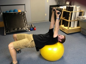 Exercise ball serratus punches