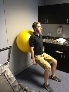 Wall squats with exercise ball