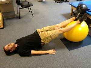 Straight leg bridge with exercise ball