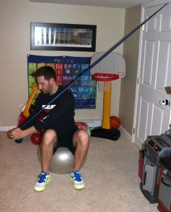 Downward chop with resistance band sitting on stability ball