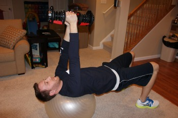 Bridge on exercise ball with weight pass