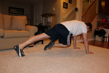 High plank with knee to opposite elbow
