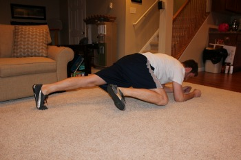 Plank with knee to elbow motion