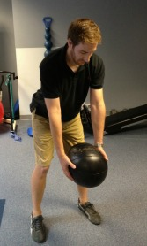 Setup for the medicine ball golf swing exercise