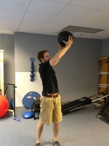 medicine ball squat with rotation