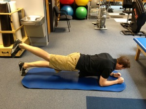 Plank with leg extension