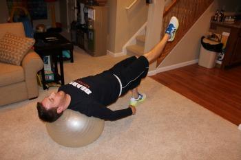 Stability ball bridge with leg extension