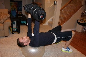 Dumbbell fly on stability ball