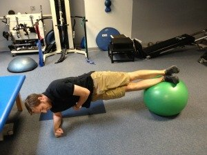 Side planks with exercise ball