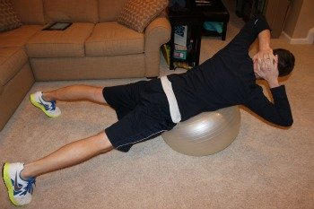 Back extension on ball with trunk rotation