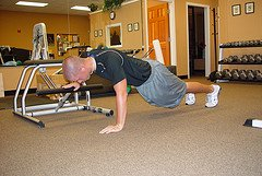 Modified push ups with pilates chair